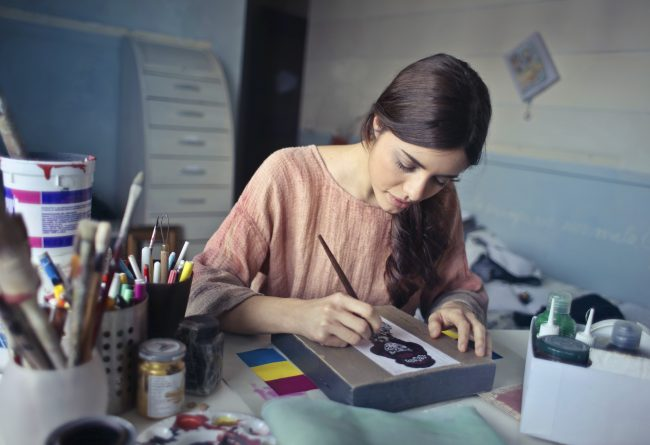 Woman adding value in workplace by creating art