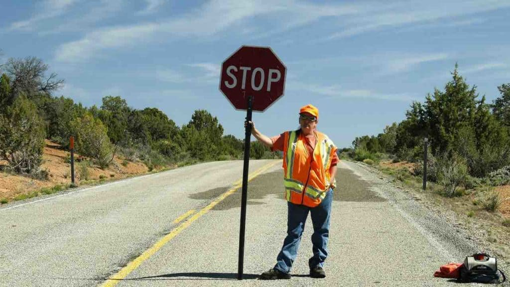 man holding stop sign telling you to set your own limits