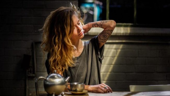 tattooed woman in shirt