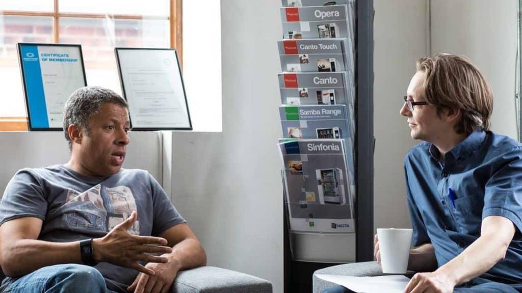 2 men having a conversation